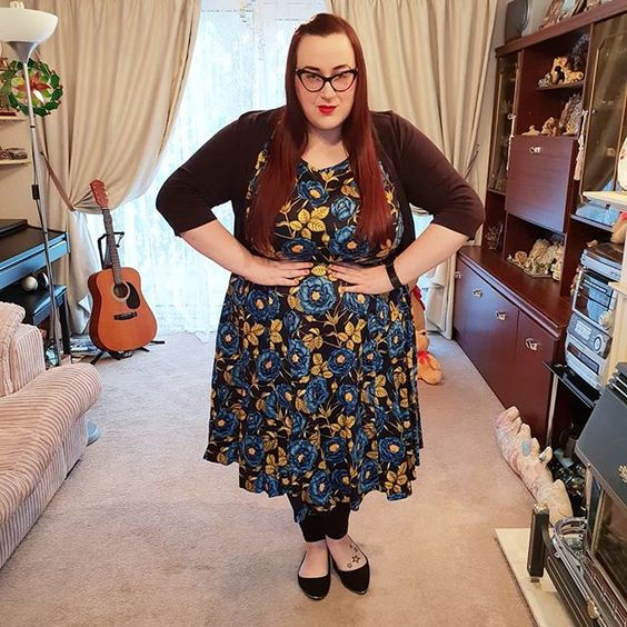plus size girl wearing Lady V London Blue Rose Hepburn Dress