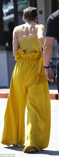 Kendall Jenner looks stuns in a bright yellow outfit