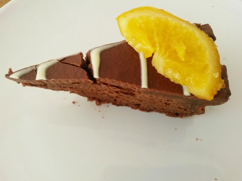 Slice of homemade chocolate, almond and orange cake. Recipe on Ginevrella