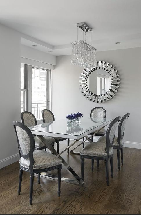 The Dining Room Looks Luxurious Materials Used With Gleaming Glass And Iron At Dinner Table Sparkling Chandeliers Create An Impression Of Glamour