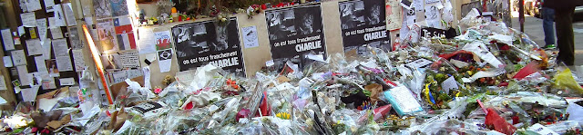 Tributes laid at the Charlie Hebdo offices after the attack, Paris, France. Photo by Loire Valley Time Travel.