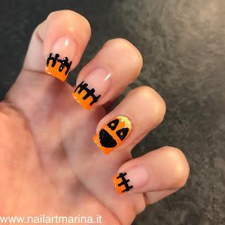 nail art molto divertente che ritrae la zucca di halloween e la stagionata