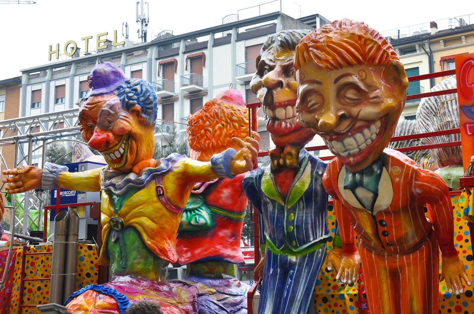 Large figures made of papier mache on a float at the Carnival in Verona