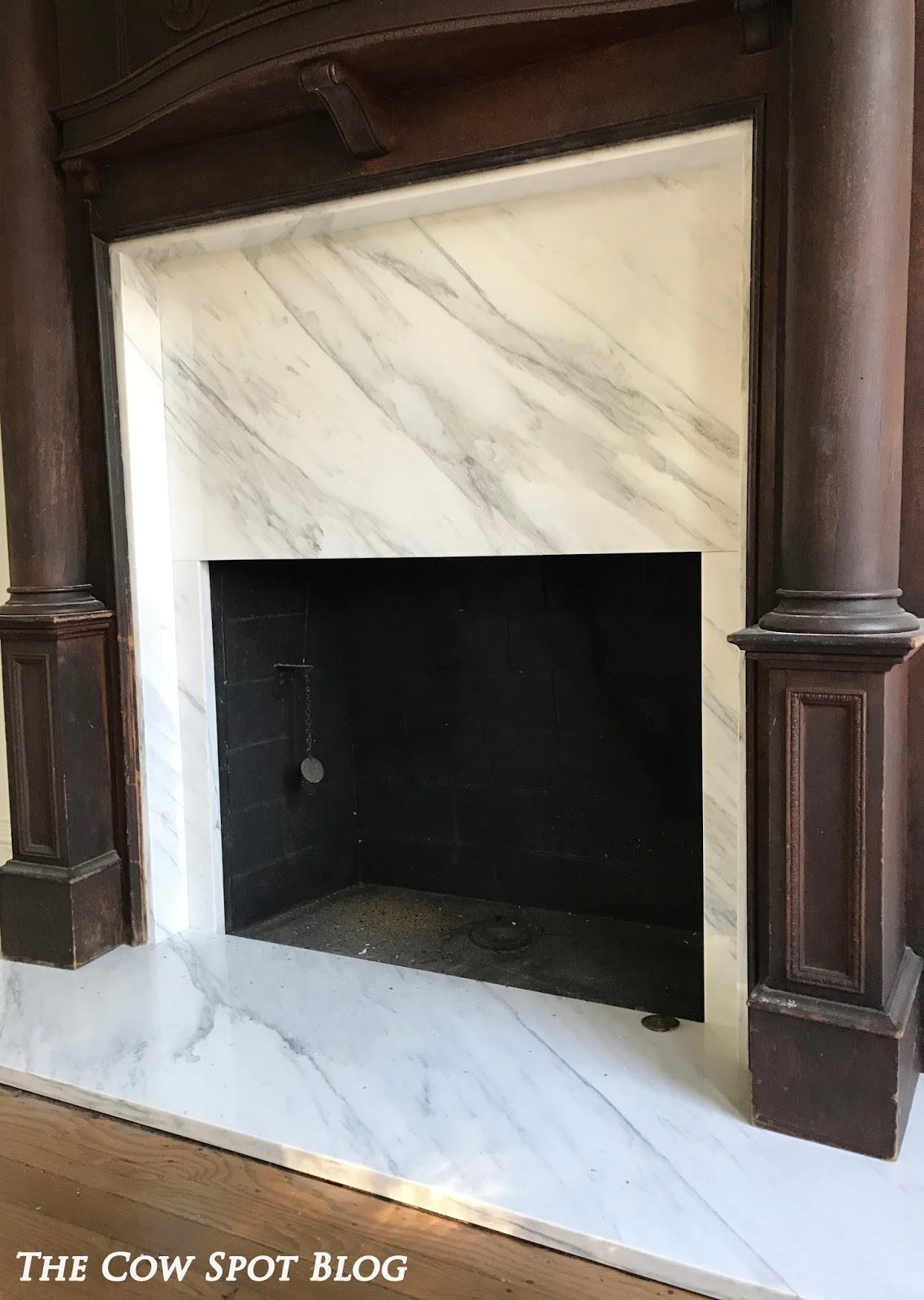 the cow spot new marble fireplace surround