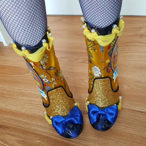 feet wearing beauty and the beast boots in yellow and blue brocade with gold glitter