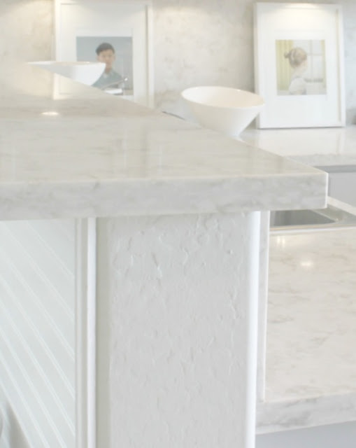 Serene chic simple Nordic French kitchen with grey cabinets and Soprano quartz countertop and backsplash
