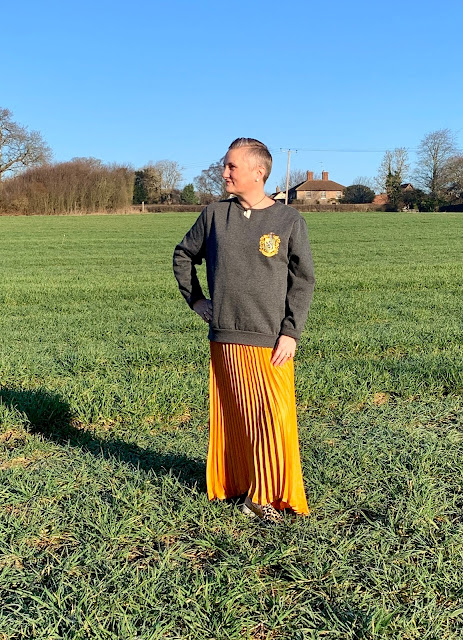 madmumof7 in Harry Potter Hufflepuff sweatshirt and yellow sun ray pleated skirt