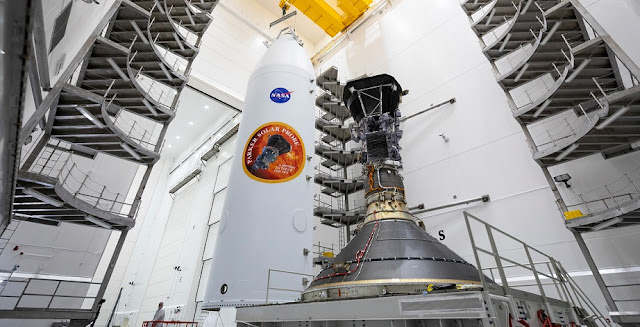 """Parker Solar Probe, which contains the U.S. Naval Research Laboratory's Wide-Field Imager for Solar Probe (WISPR), is mounted atop its third stage rocket motor at Astrotech Space Operations ahead of the probe's scheduled launch on Aug. 11, 2018, from Cape Canaveral Air Force Station in Florida. WISPR is the only instrument that will capture images of the Sun's atmosphere on a NASA mission to """"touch the Sun"""" and study the Sun's effects on many of the technologies that the U.S. Navy relies on to conduct missions around the world. (U.S. Navy photo by Ed Whitman courtesy of NASA / Applied Physics Lab/Released)"""