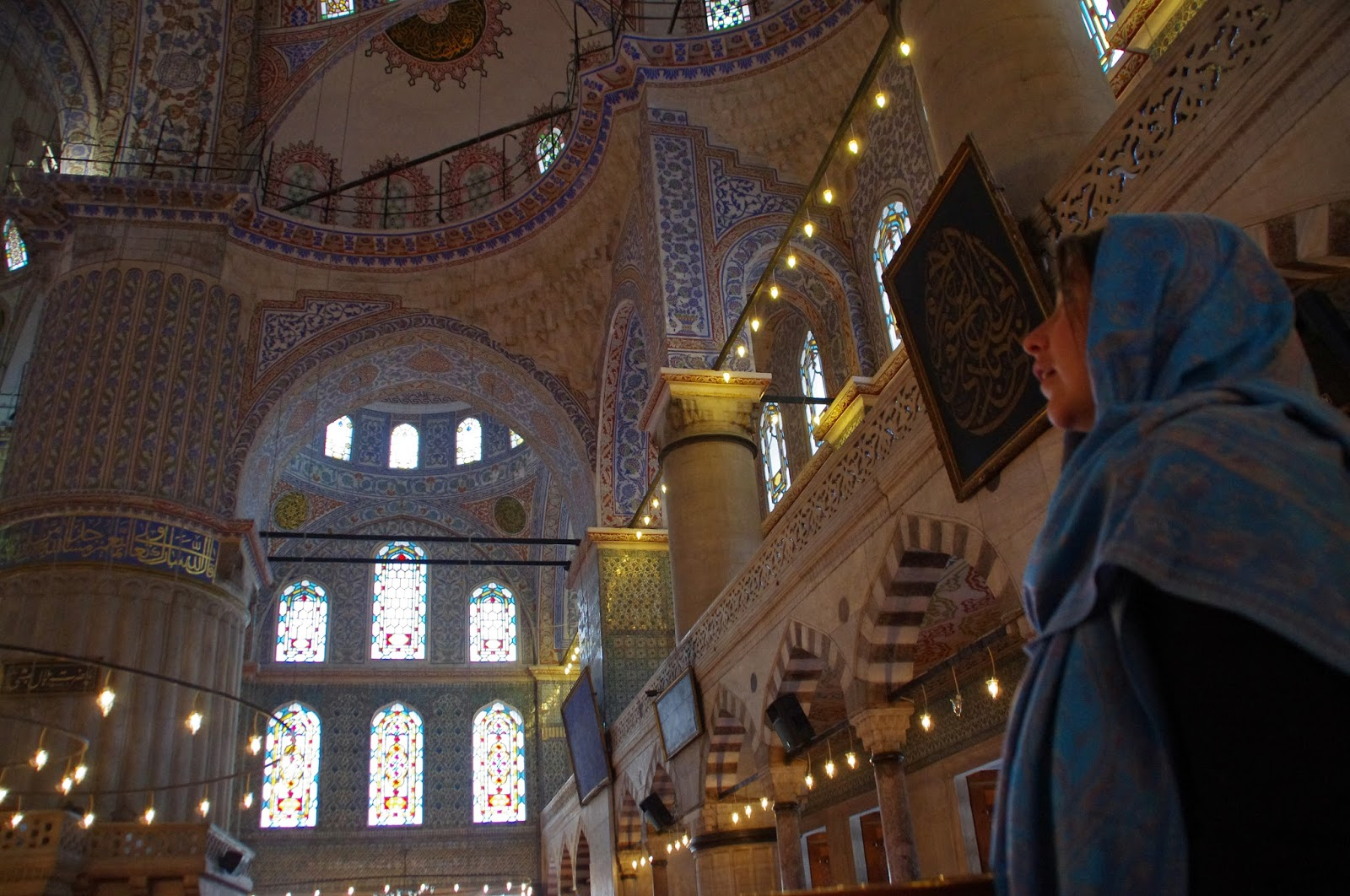 Girl staring up to Blue Mosque Ceiling Istanbul