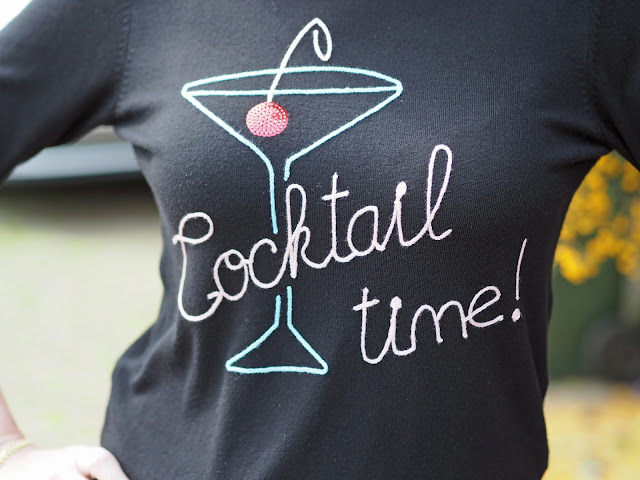 What Lizzy Loves. Cocktail glass logo top, sequin cherry