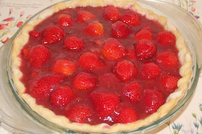 Close up of a finished fresh strawberry pie.