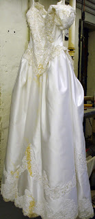 Before Wedding Gown Restoration. 1990's Wedding Dress restored after improper storage.