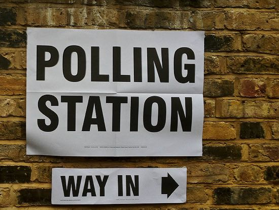 Photograph of a polling station sign. Image by secretlondon123 released under Creative Commons