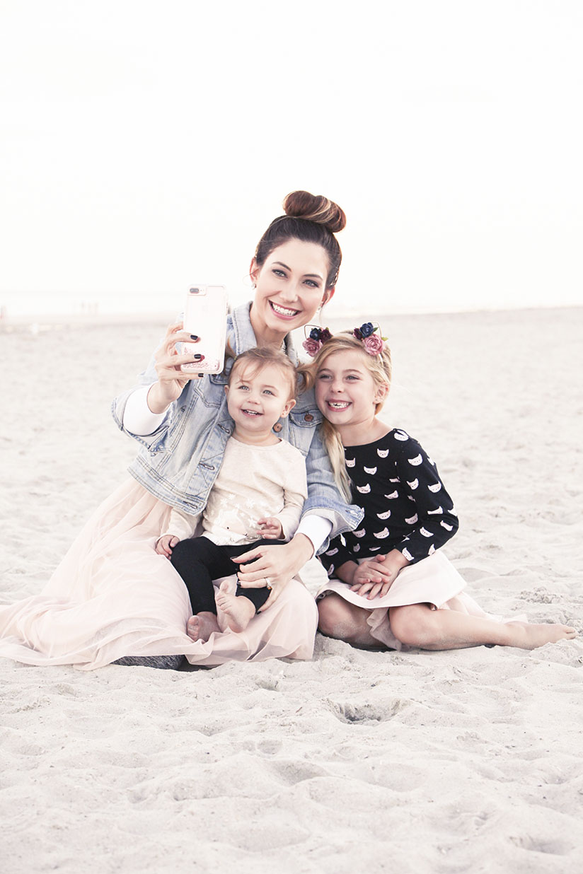 Amy West and daughters pose for a selfie