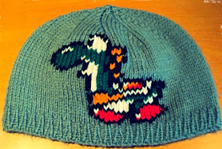 http://damnitjanetletscrochet.blogspot.ca/2011/11/yoshi-beanie-knitting.html