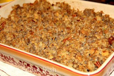 A cornbread and bread dressing, made with tart apple, hot sausage and pecans.