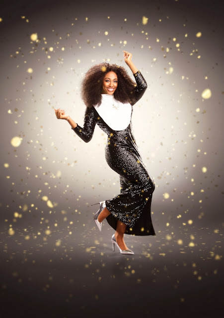 Alexandra Burke in a sparkly black habit and silver heels as Sister Mary Clarence