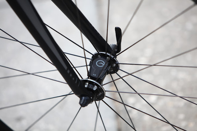 Power Tap Speed/Cadence Sensor Mounted On Bicycle Front Hub.
