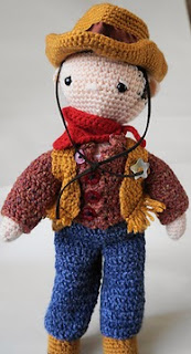 http://www.ravelry.com/patterns/library/cowboy-outfit---my-little-crochet-doll