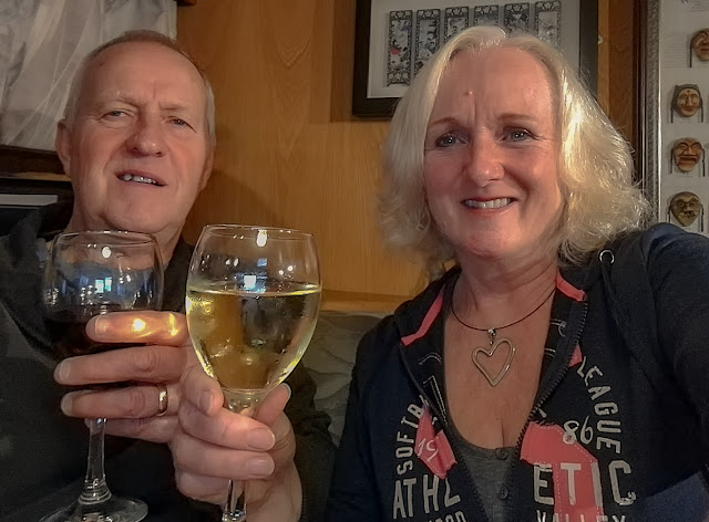 Photo of us toasting Ravensdale on our second liveaboard anniversary