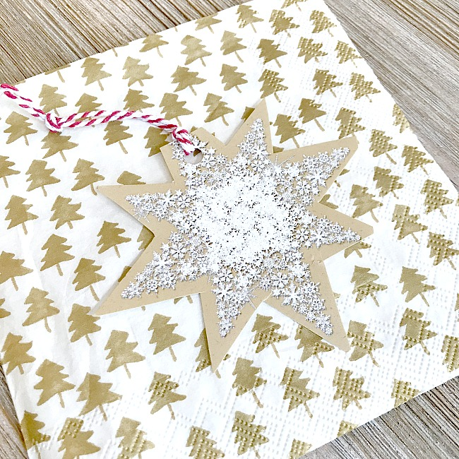 Cut old christmas cards into new gift tags