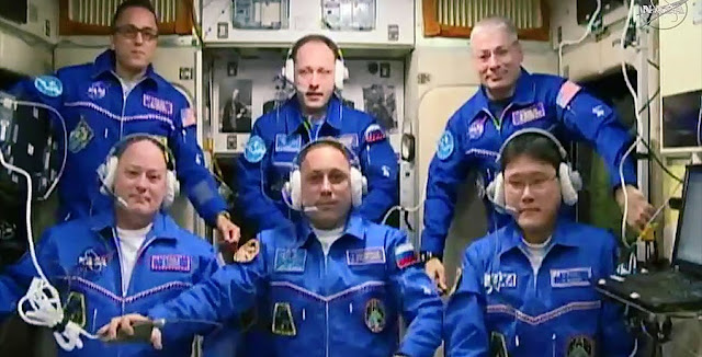 The newly-expanded Expedition 54 crew gathers in the Zvezda service module for ceremonila congratulations from family and mission officials. Credit: NASA TV