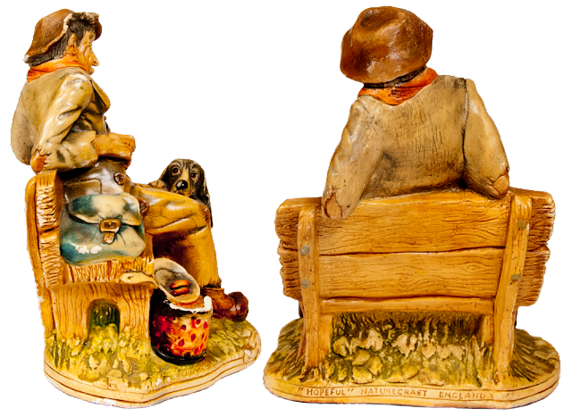 Two back views of the old tramp figurine on his bench.