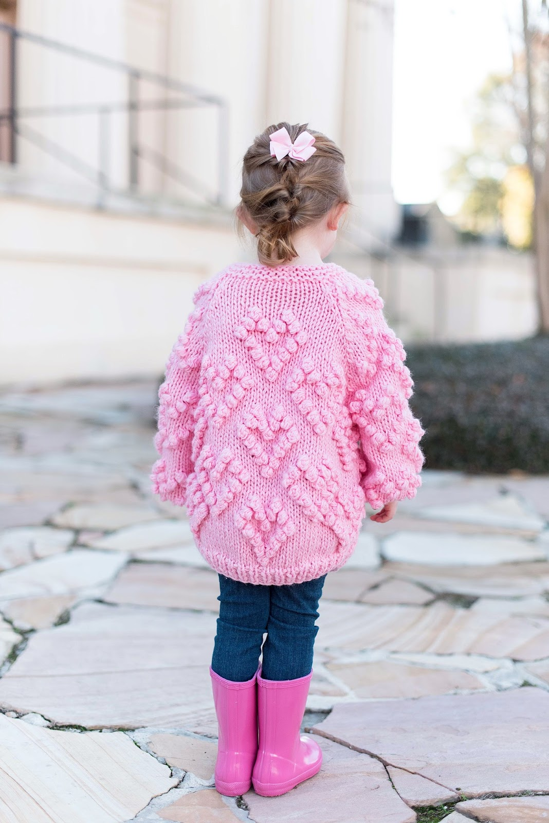 Heart Cardigan for kids - All details can be found on Something Delightful BlogHeart Cardigan for kids + Pink Hunter Boots - All details can be found on Something Delightful Blog