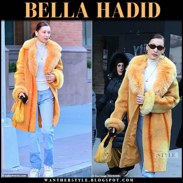 Bella Hadid in orange fur collar coat, re/done jeans and maison margiela sneakers model winter outfit december 29