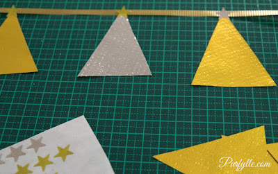 Christmas tree garland - Leave a space between each Christmas tree