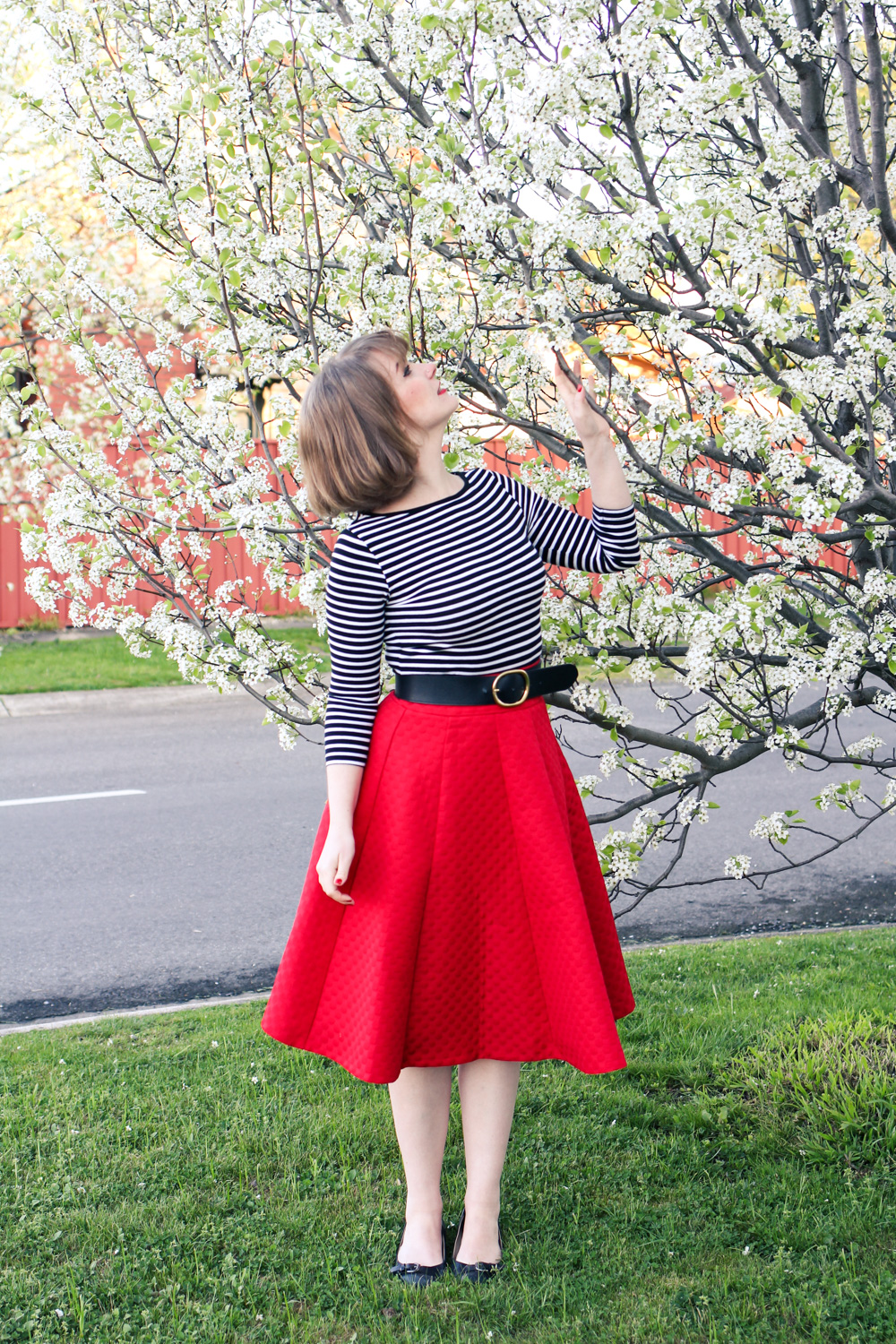 @findingfemme wears red skirt with white cherry blossoms in Ballarat