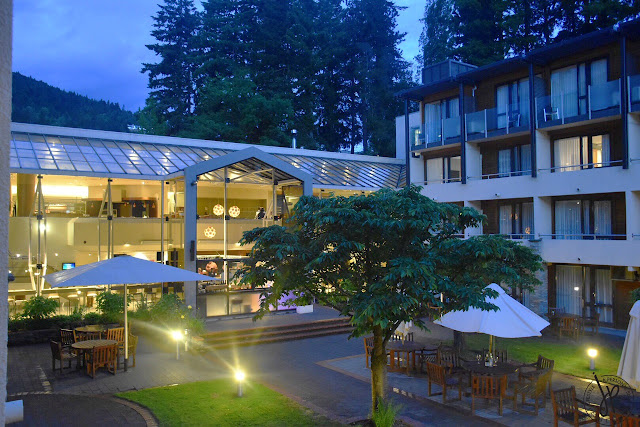 hotel premises, tables, chairs, trees, room with veranda