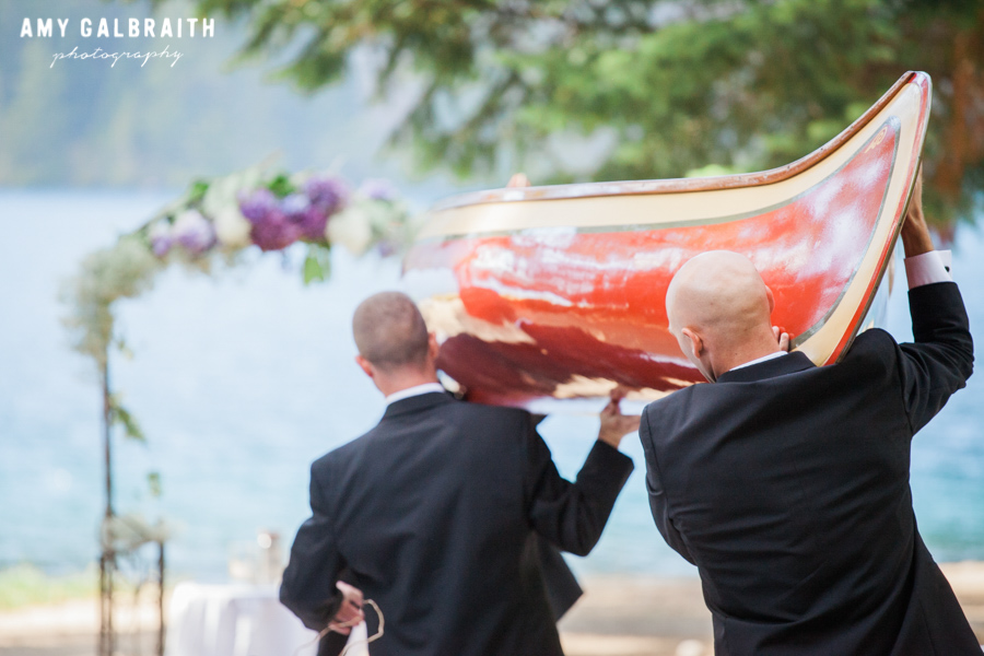 groomsmen carrying a canoe