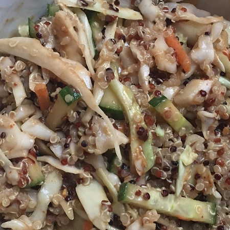 Quinoa salad with spicy peanut dressing
