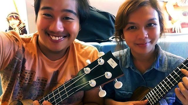 Plucking a ukulele at UkeHUB Kafe in Mactan Island Lapulapu City Cebu Philippines