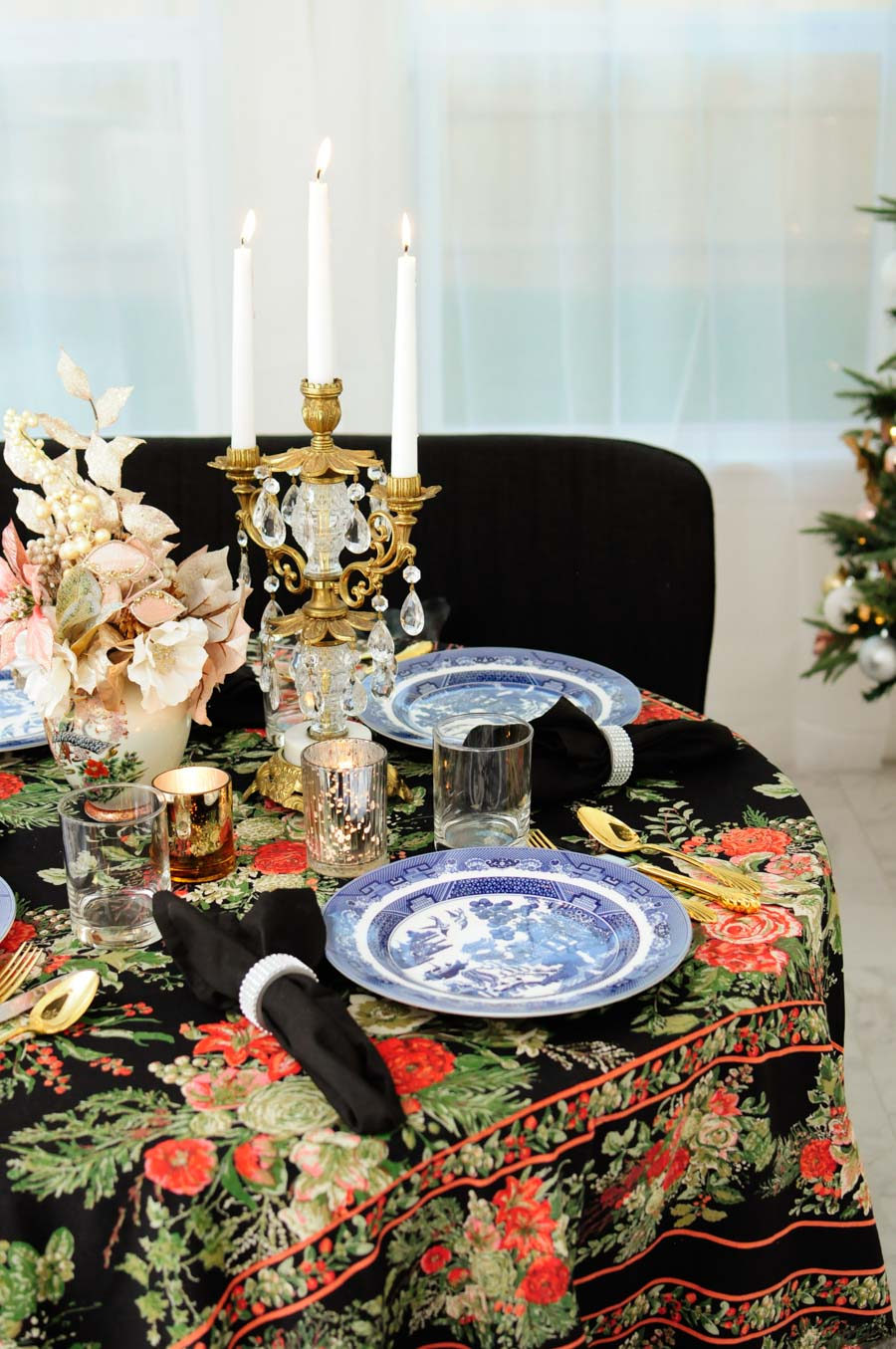 A small dining area or breakfast nook gets glammed up for the holidays with touches of blush, gold, and silver, plus florals and chinoiserie and vintage home decor elements.