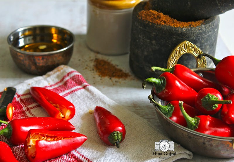 or lal mirch ka bharwa achaar is reddish chilli pickle stuffed amongst homemade spice mix soaked Lal Mirch ka Achaar (Stuffed Red Chili Pickle)