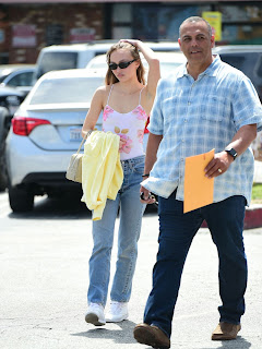 Lily-Rose Depp In White Top And Blue Jeans
