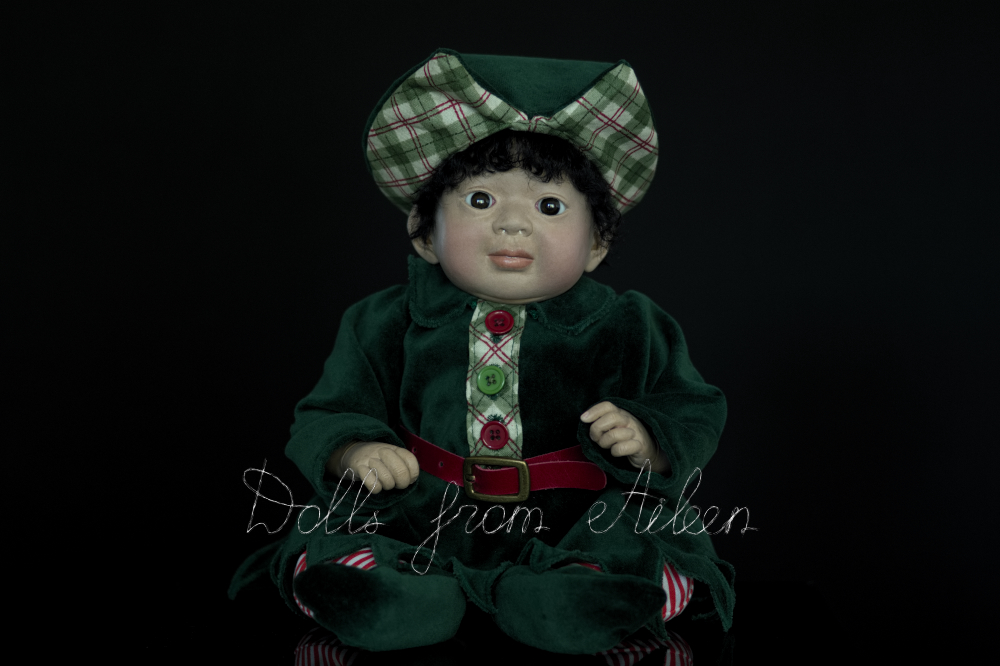 ooak Christmas elf art doll looking at the camera