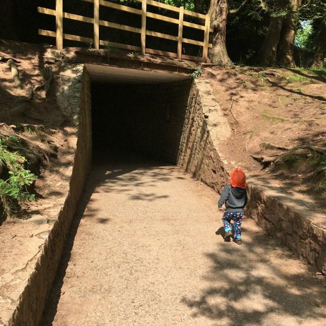 St-Fagans-Castle-and-Gardens-tunnel-with-toddler