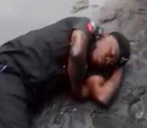 drunk nigerian police man falls into gutter