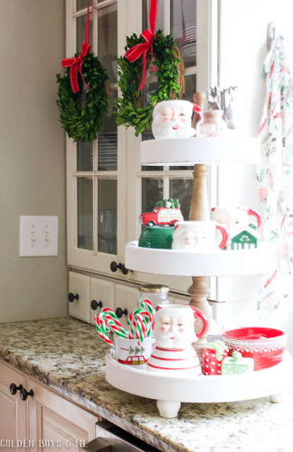 Tiered stand with whimsical holdiay decor in farmhouse style kitchen