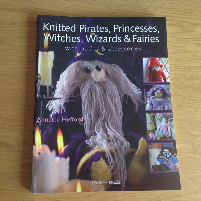 Picture of front of book showing knitted wizard