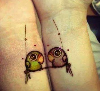 Two parrots in love. Αwesome wrist tattoo.
