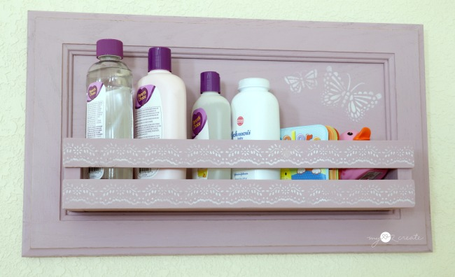 cabinet door shelf with baby bath supplies