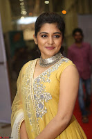 Nivetha Thamos in bright yellow dress at Ninnu Kori pre release function ~  Exclusive (45).JPG