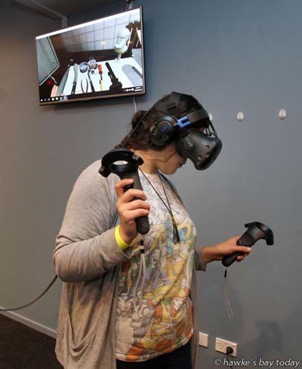 Tamara Ching, Hastings, using the HTC Vive virtual reality which was only released in the US on 01/06/16 - opening night of The Battle Cave, a new business at 1/1 Dickens St, Napier. photograph