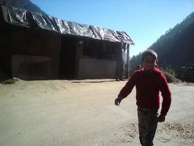 A smiling chirpy village kid wishing us Happy Diwali in the mountains