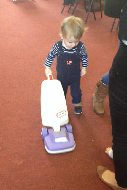 Toddler with toy Vacuum cleaner
