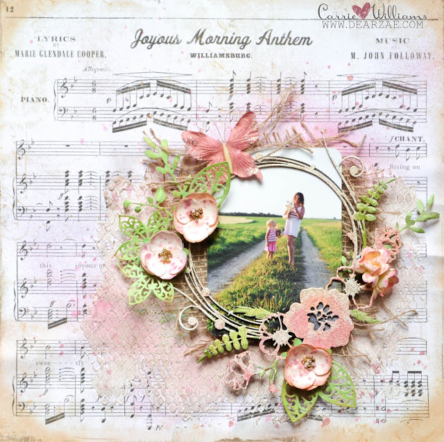 Mixed media layout in pink and peach with green with texture paste, Prima die cut leaves, Blue Fern Studios chipboard and embossing powder, and burlap with flower embellishments.